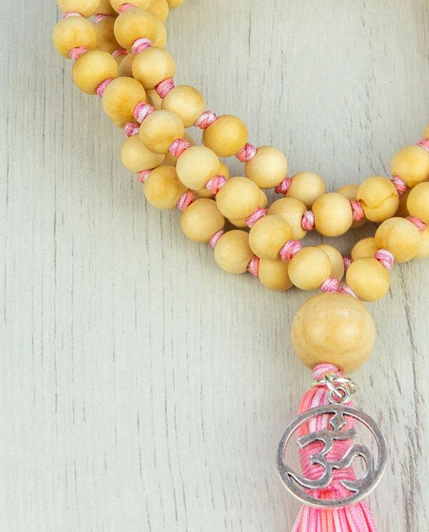Japamala madera nudos rosada detalle